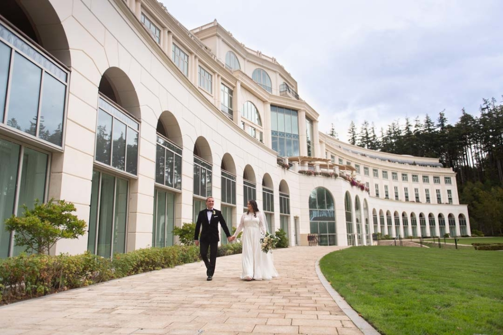 Bride and groom walking together on the grounds of Powerscourt Hotel
