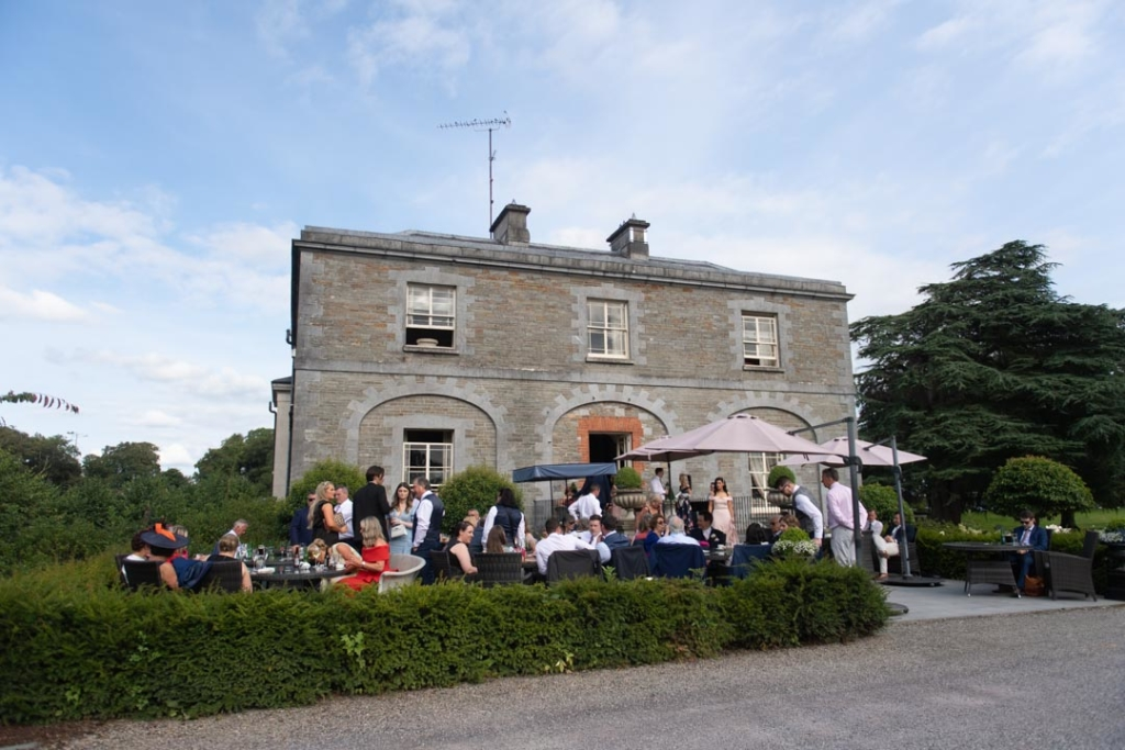 The wedding guests at the drinks reception outside Tankardstown House in Meath