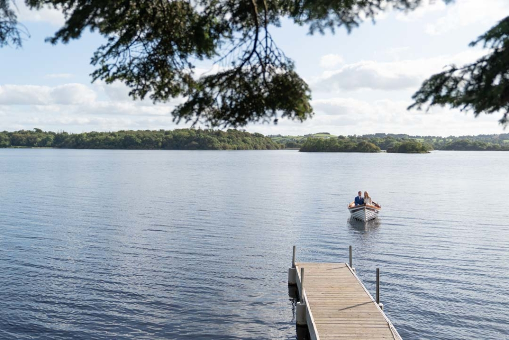 Bride and groom in a boat on the lake at the Virginia Park Lodge wedding venue