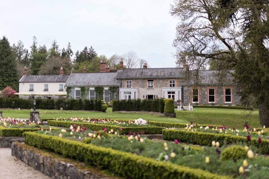 The gardens at the Virginia Park Lodge with the house wedding venue in the background