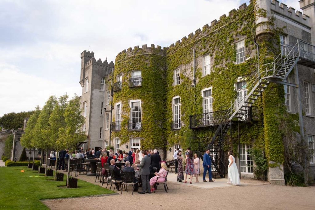 The guests outside at the drinks reception at the Bellingham castle wedding venue in Ireland
