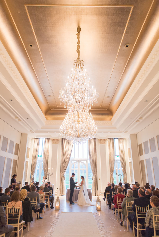 Bride and groom saying their vows in the ceremony room at one of the top wedding venues in Ireland, Adare Manor