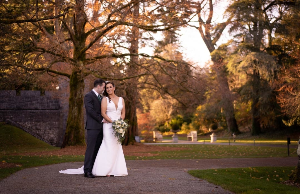 Bride and groom standing together in the grounds of the Ashford Castle hotel
