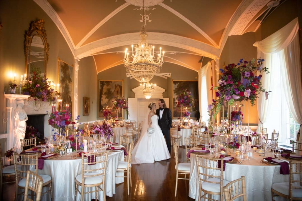 Bride and groom standing in the wedding reception room set out for dinner at the Luttrellstown Castle wedding venues in Ireland