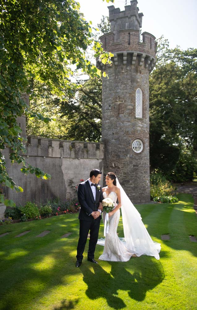 Sarah Roberts and James Stewart on the grounds of Luttrellstown Castle on their wedding day in Ireland