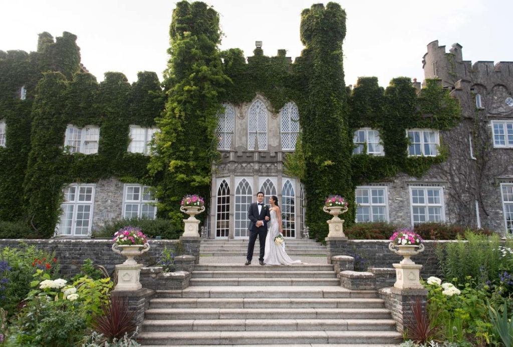 Bride and groom standing together on the steps of the Luttrellstown Castle wedding venues in Ireland