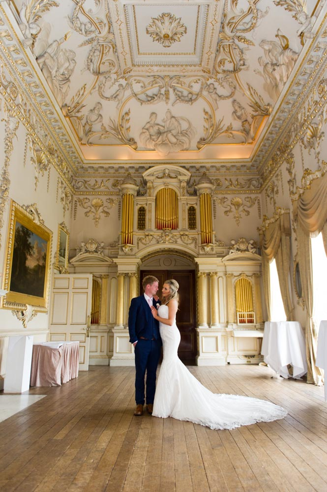 Bride and groom standing in the gold room at the Carton House venue in Ireland