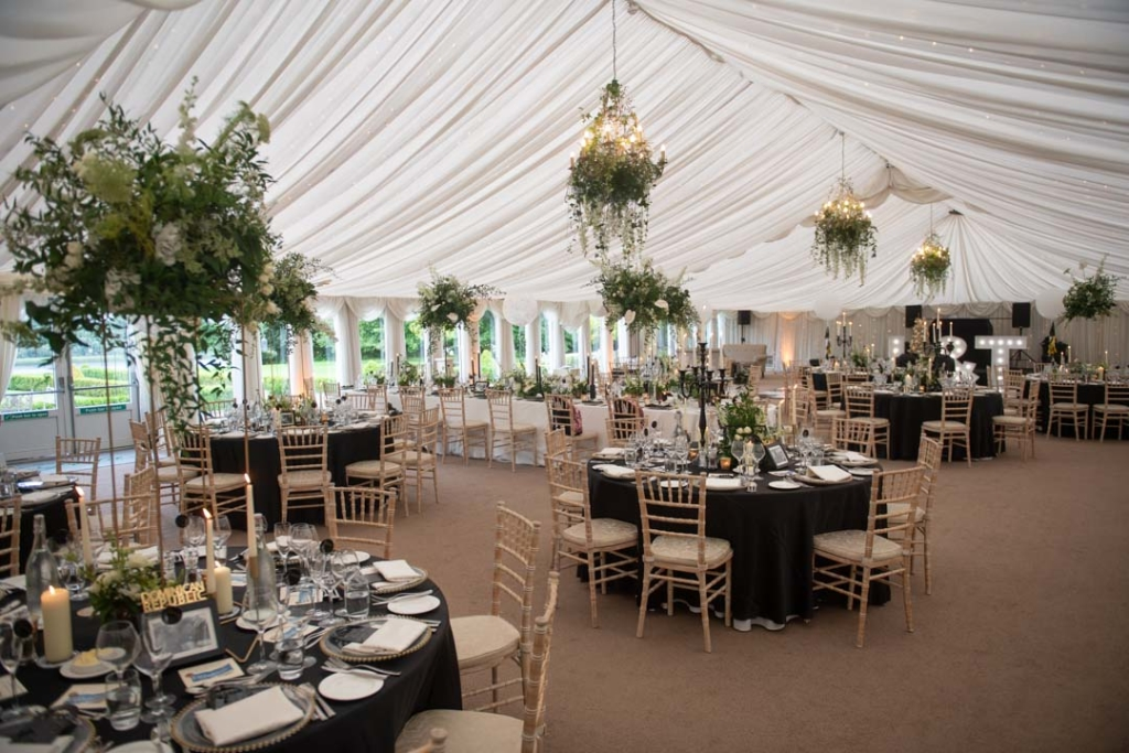 The wedding marquee set up for dinner at the Castle Leslie wedding