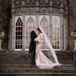 Groom kissing Brides head outside on the steps of Luttrellstown Castle