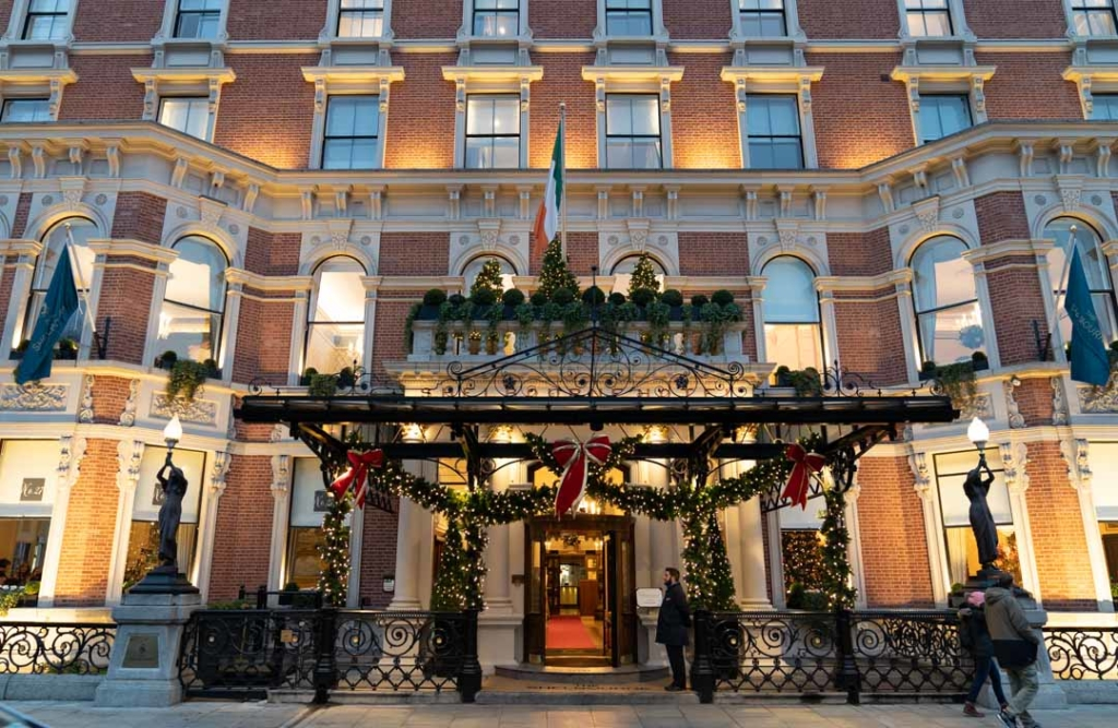 Outside of the Shelbourne Hotel decorated with red bow and Christmas lights