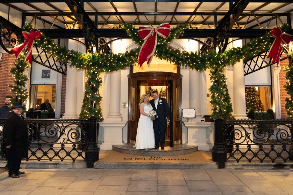 Bride and groom at the front door of the Shelbourne hotel