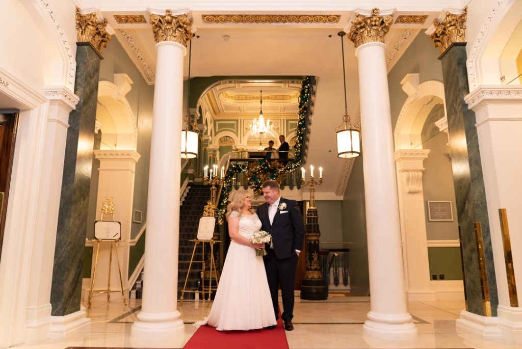 Bride and groom standing together in the hall at the Shelbourne Hotel in Dublin