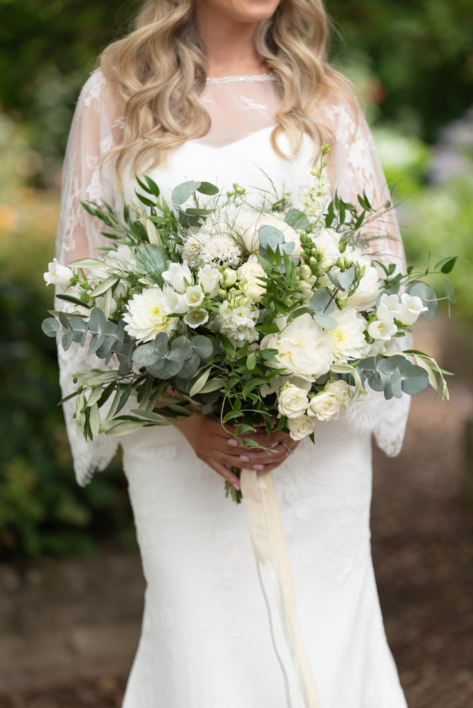 The Brides white and green flower bouquet