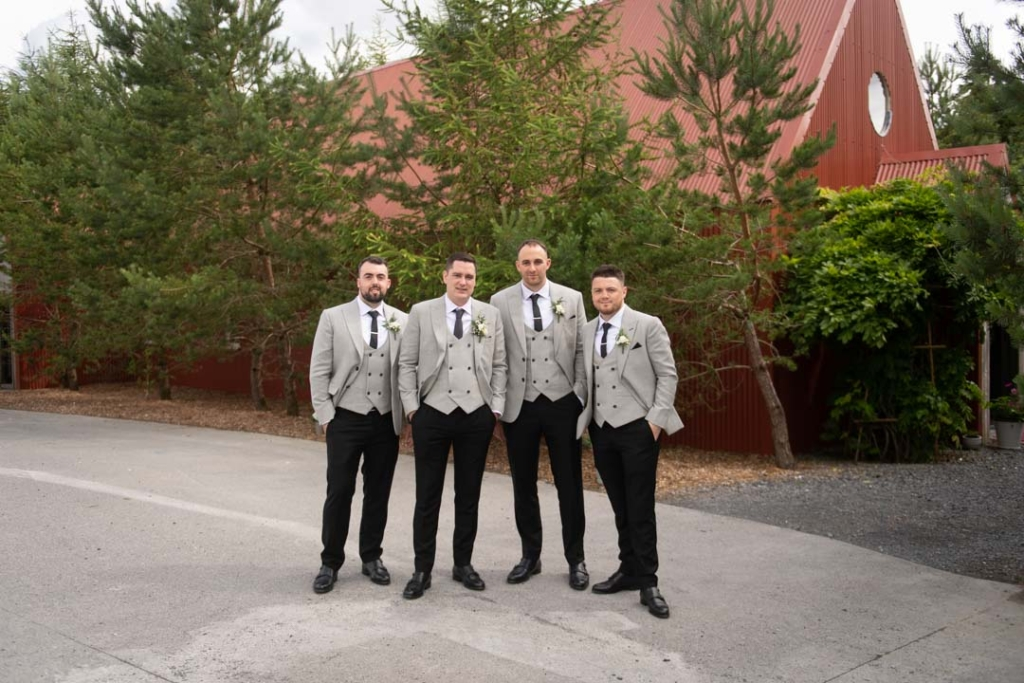 The Groom and his Groomsmen standing outside the Tin Chapel at Mount Druid