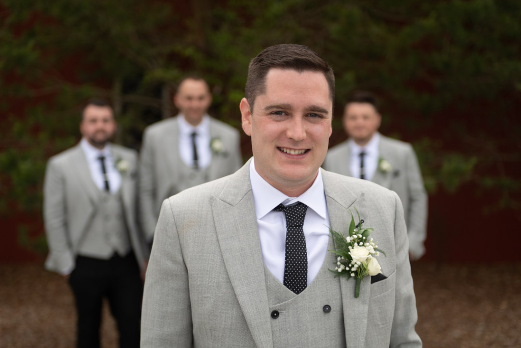 The Groom with his Groomsmen in the background
