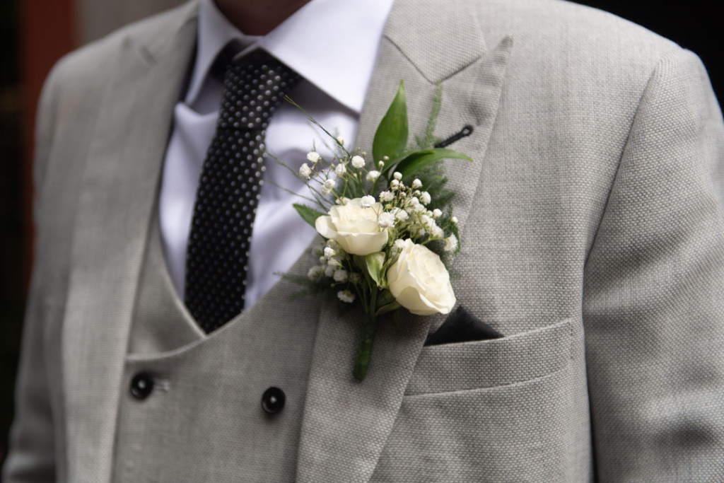 The Grooms wedding white flower button hole