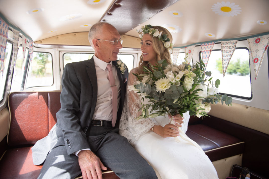 Bride and her dad in the back of the wedding volkswagen van at Mount Druid
