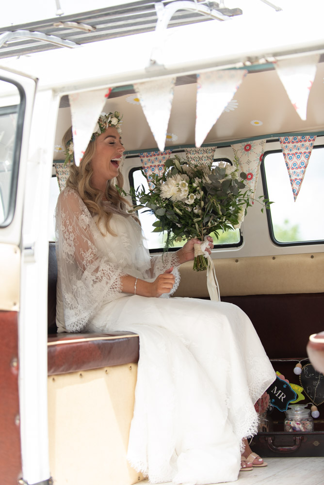 Bride laughing in the back of the volkswagen wedding van at Mount Druid