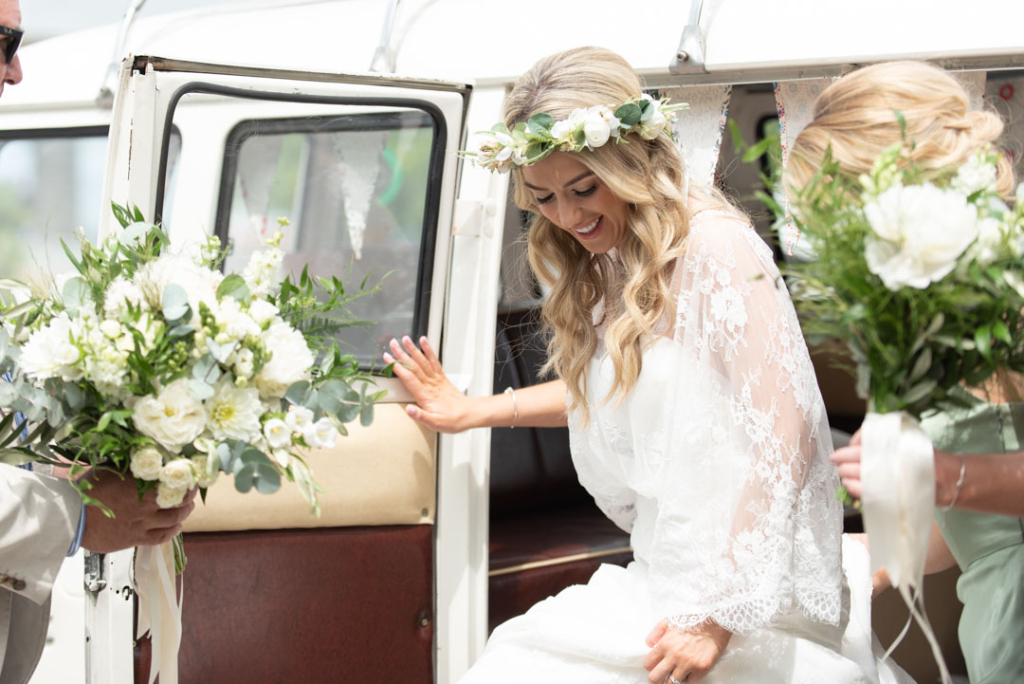 Bride stepping out of her wedding volkswagen van at Mount Druid