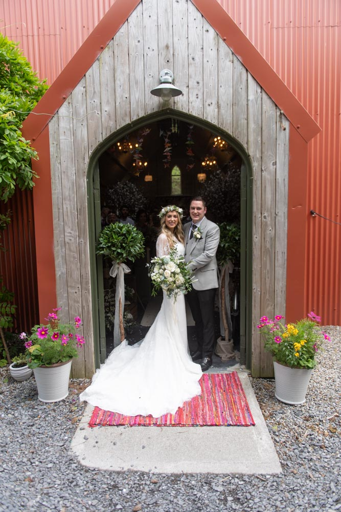 Bride and Groom at the entrance of the Tin Chapel at Mount Druid