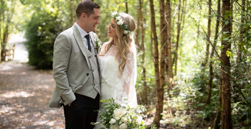 Bride and Groom standing together in the forest at Mount Druid