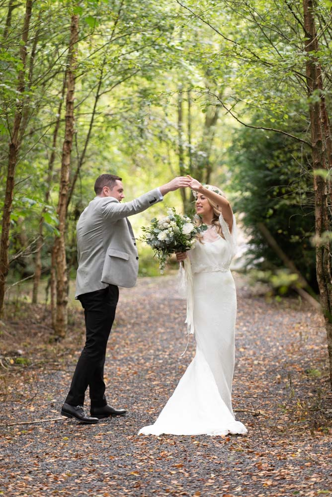 Bride and Groom dancing in the forest at Mount Druid