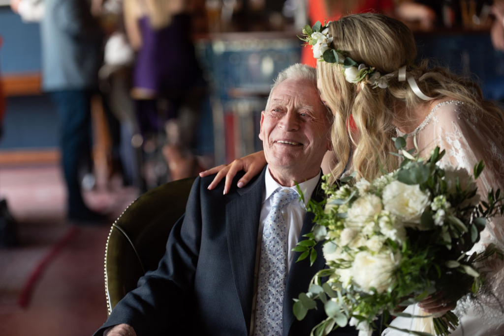 Bride kissing her Grandad on the forehead