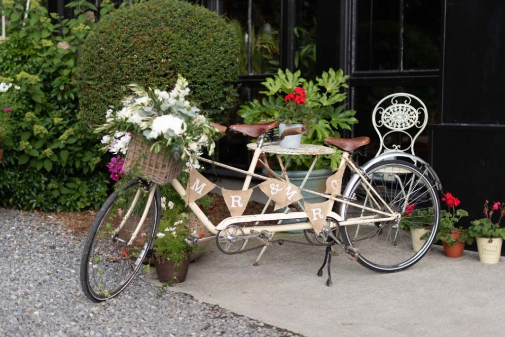 Wedding bicycle with flowers in the basket and Mr & Mrs bunting on it