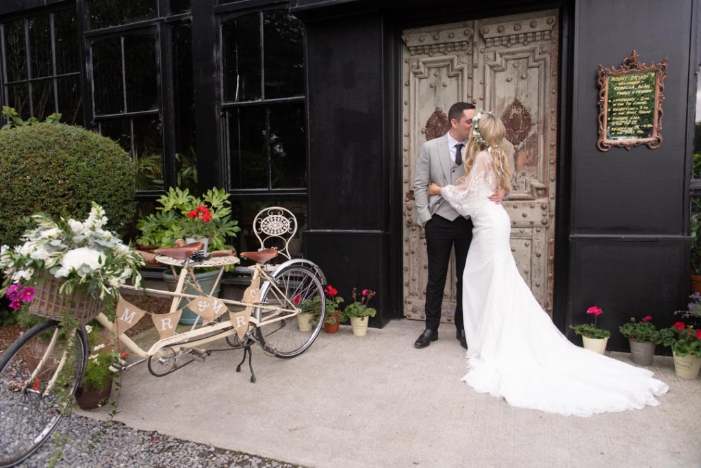 Bride and Groom at the front door of the Barn at Mount Druid