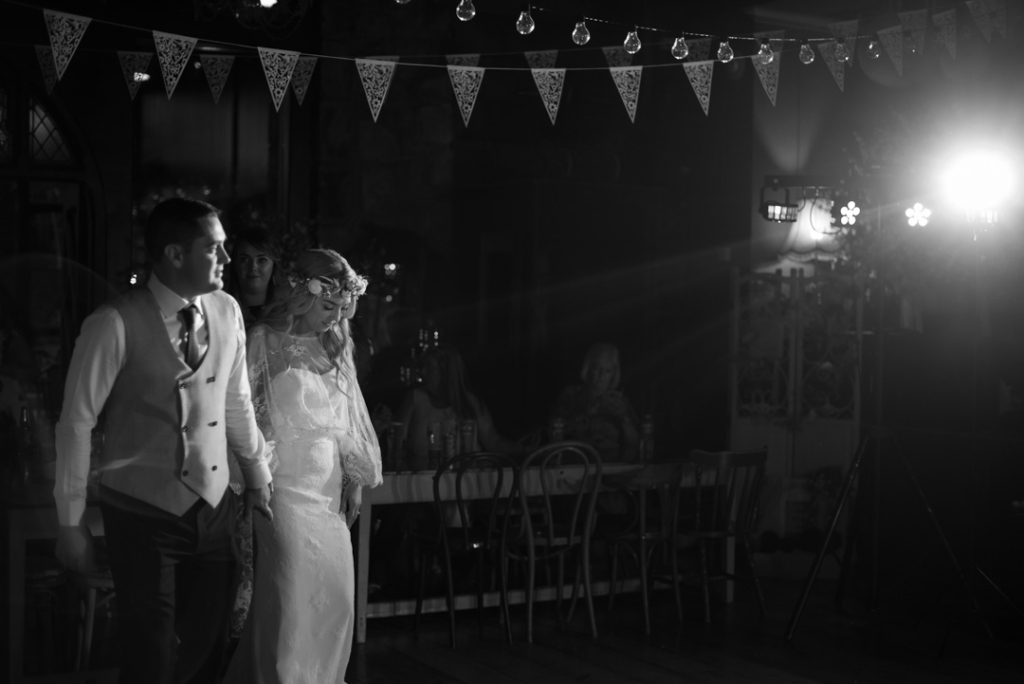 Bride and Groom walking onto the dance floor for their first dance at Mount Druid