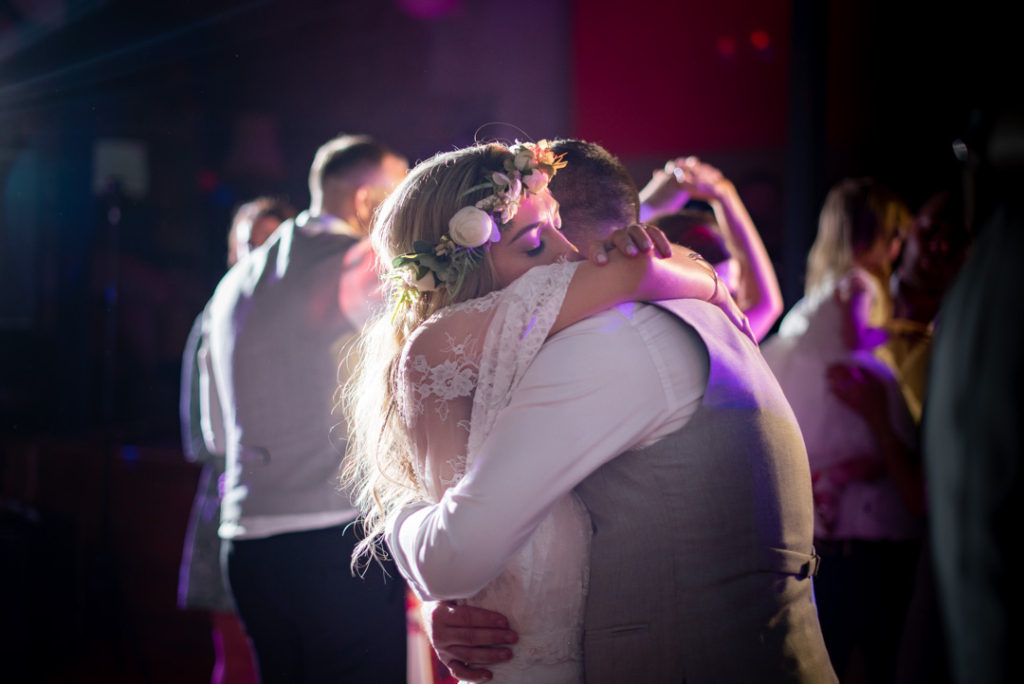 Bride and Groom hugging on the dance floor