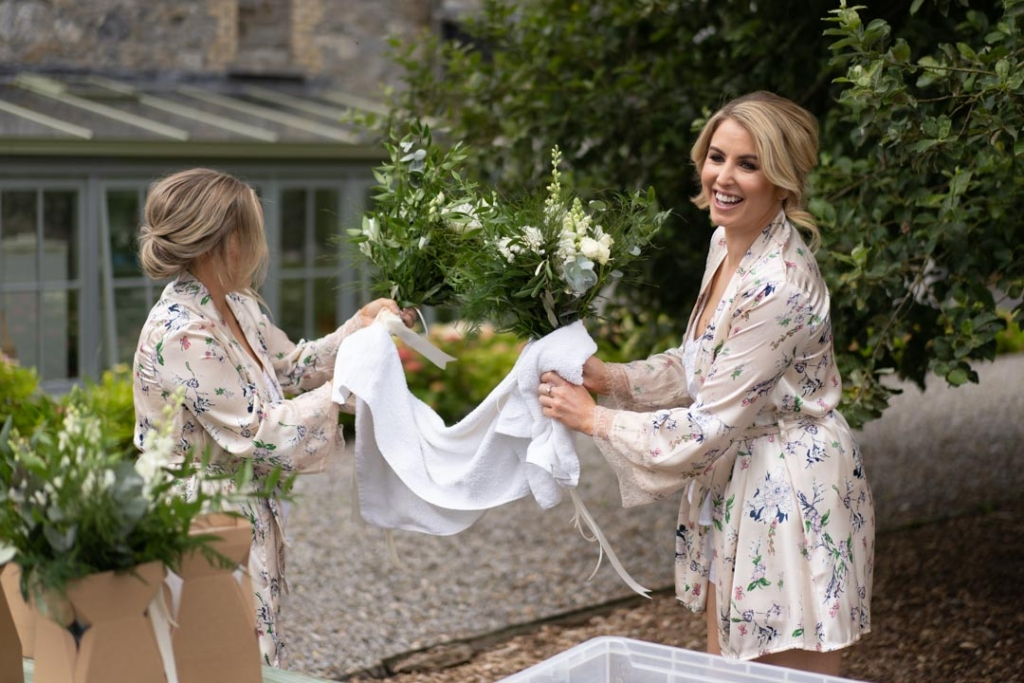 Bridesmaids drying the wedding flower bouquets