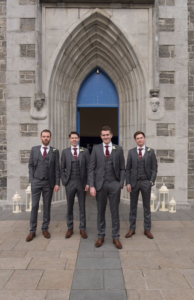 Groom and his groomsmen standing outside the Church