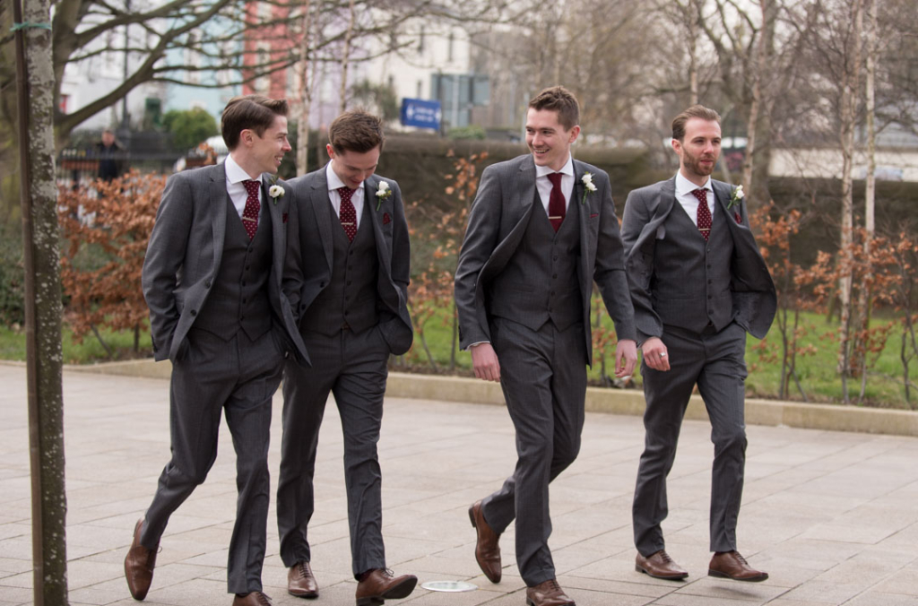 Groom and groomsmen walking into the Church