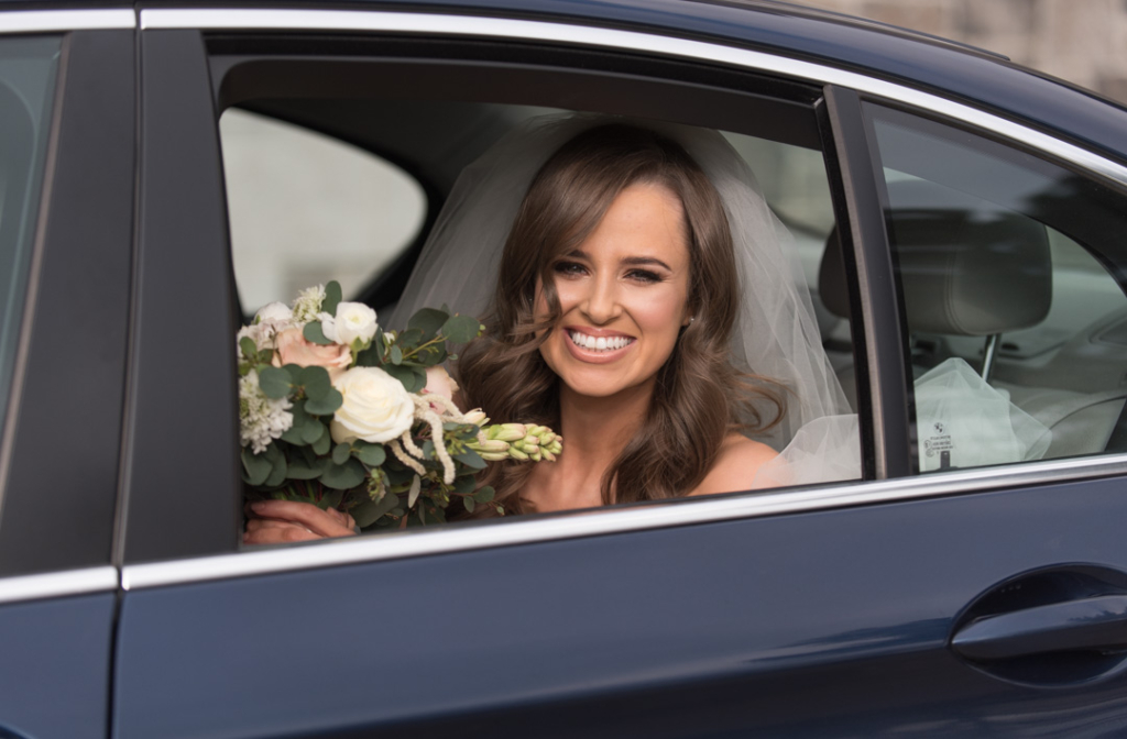 Bride arriving at the Church in the back of the wedding car