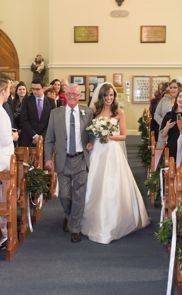 Bride and her dad walking up the Church aisle