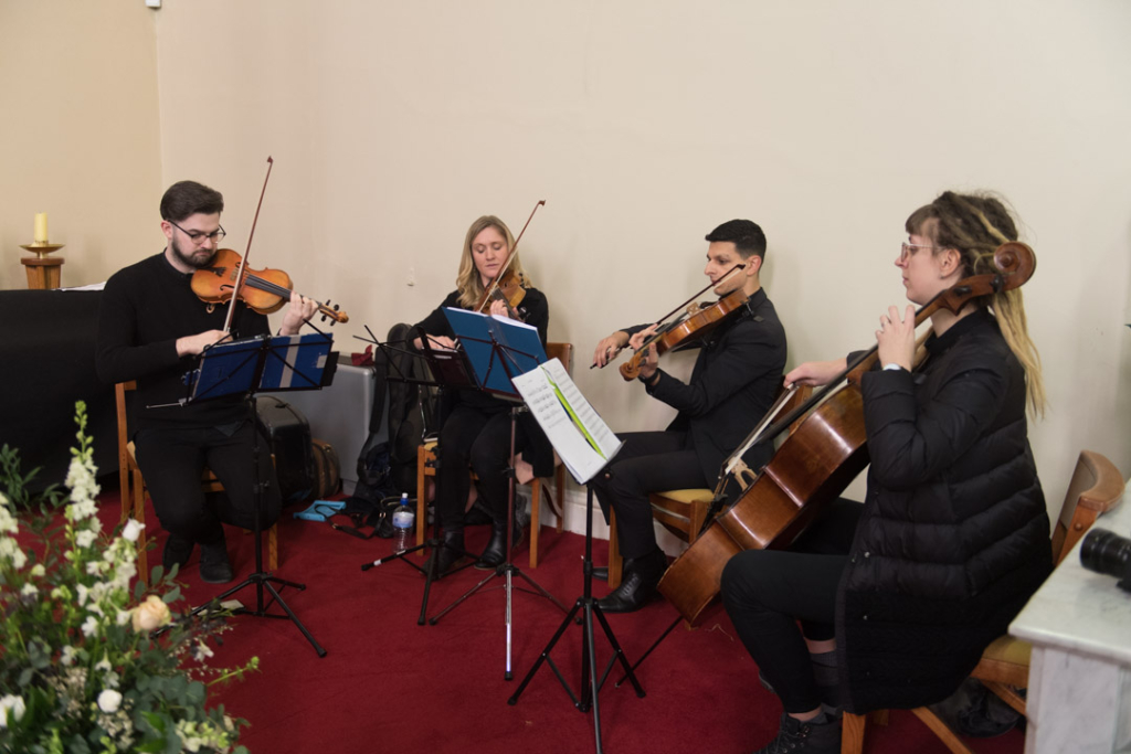 String quartet playing at the Church wedding