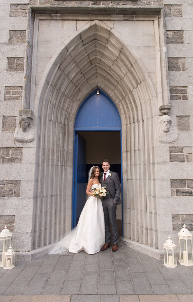 Bride and Groom standing outside the Church doors