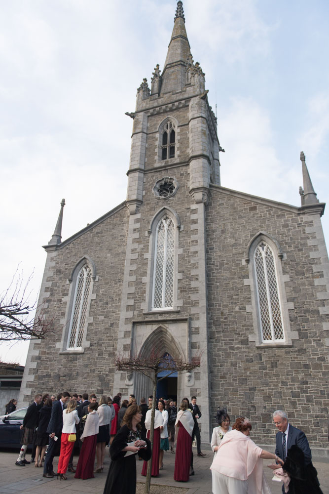The wedding guests chatting outside the Church in Malahide