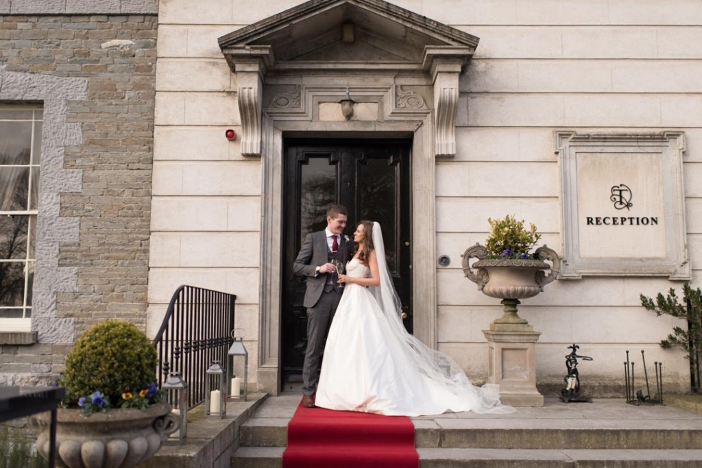 The Bride and Groom standing outside the front door at Tankardstown House