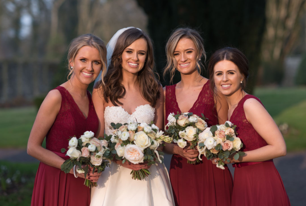 Bride and her Bridesmaids holding their flower bouquets for their Tankardstown House wedding photos