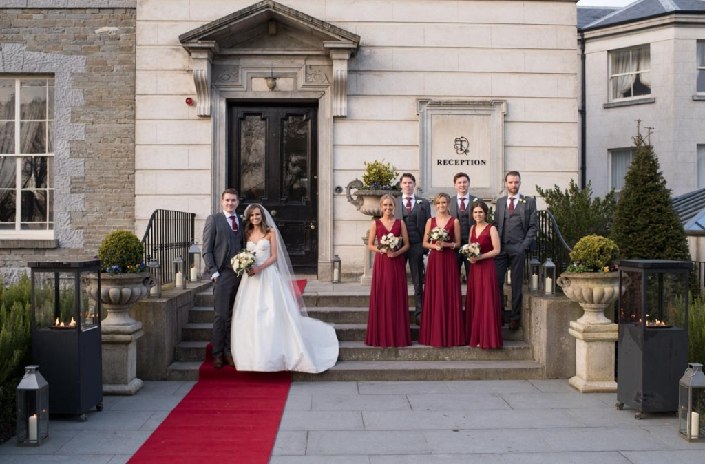 Bride and Groom with their bridal party outside the front door at Tankardstown House