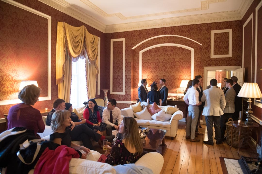 The wedding guests at the drinks reception in one of the rooms in Tankardstown House