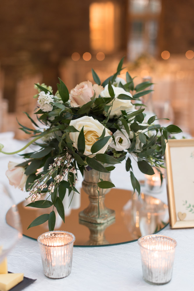 Flower arrangement in the centre of the wedding table