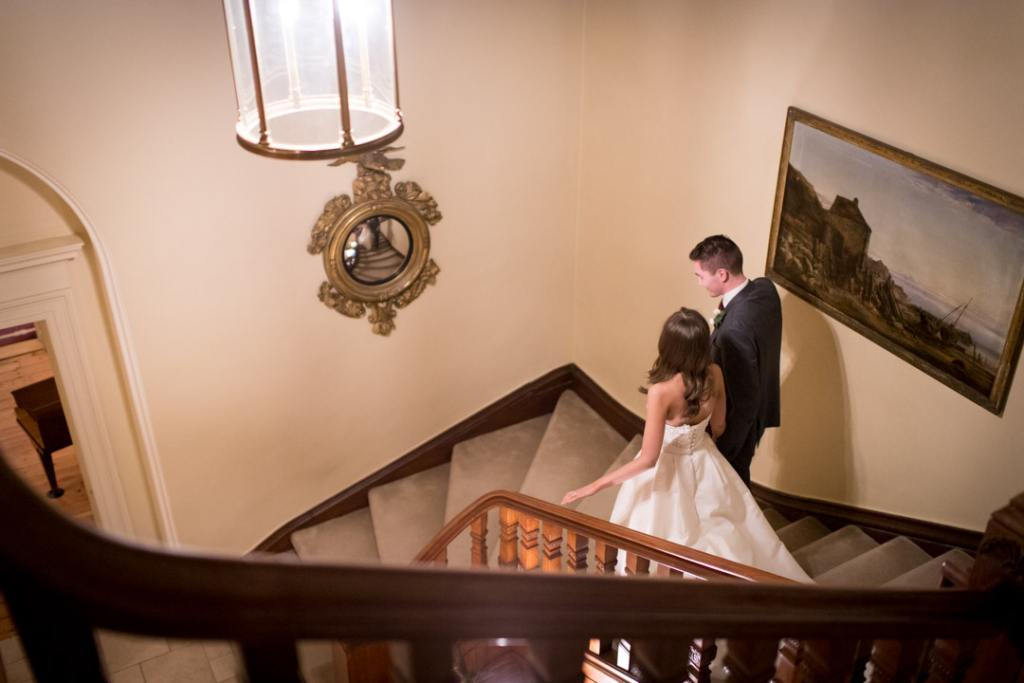 Bride and Groom walking down the stairs at Tankardstown House
