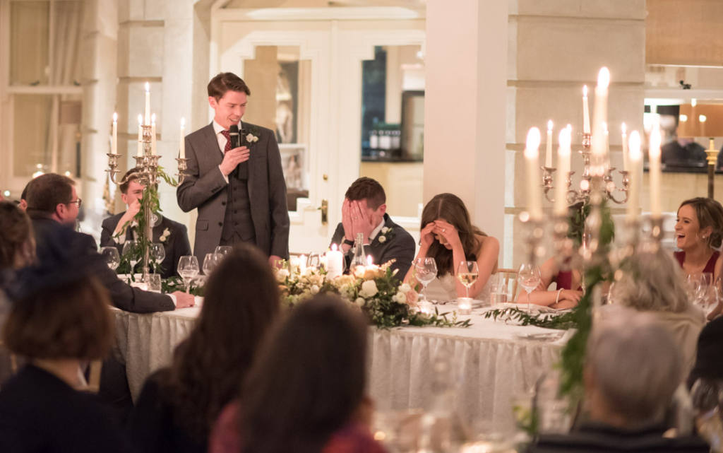 Bride and Groom holding their heads during the Best mans speech at Tankardstown House