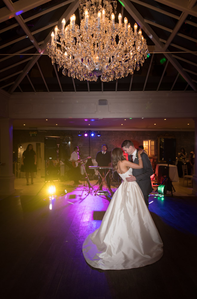 Bride and Groom dancing their first dance under a chandelier at Tankardstown House
