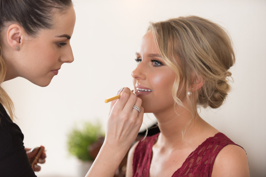 Bridesmaid getting her makeup applied