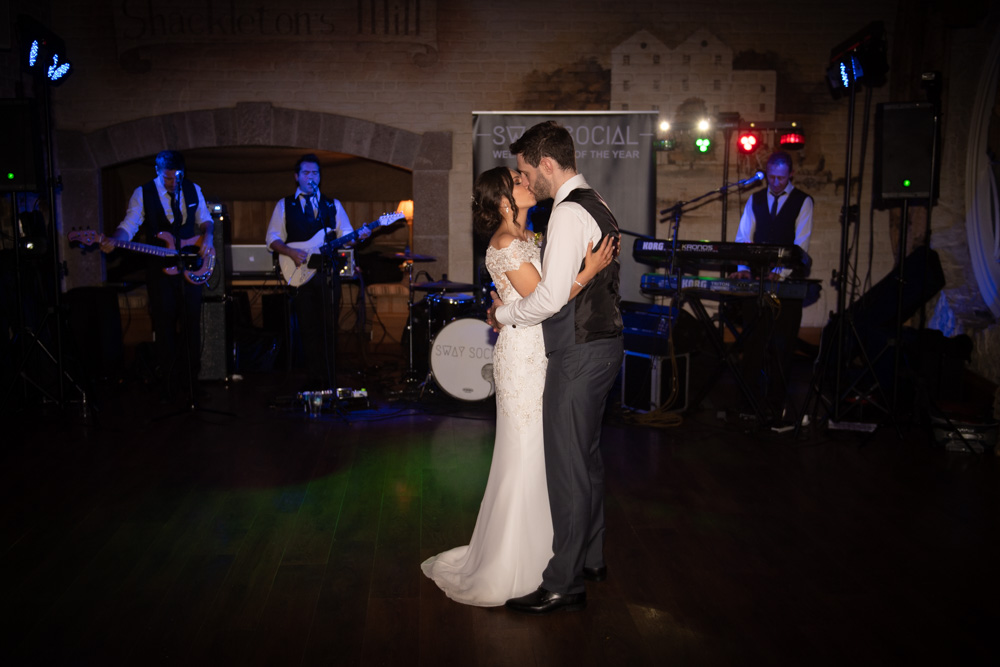 Bride and Groom kissing while dancing their first dance