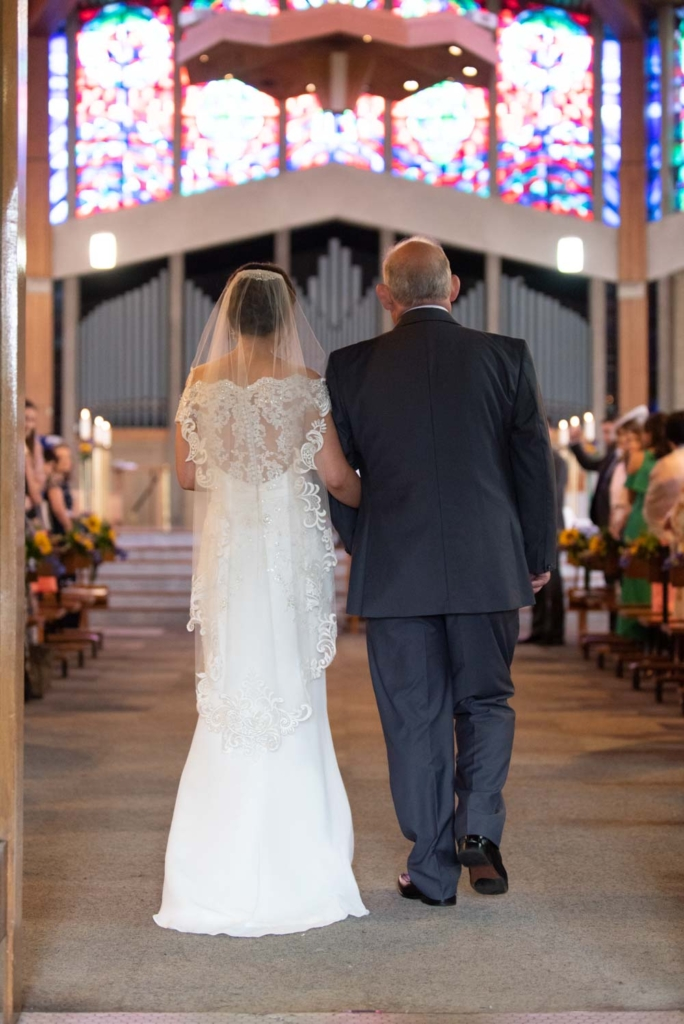 Bride and her dad walking up the Church aisle together